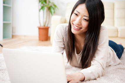 beautiful asian woman using a laptop computer
